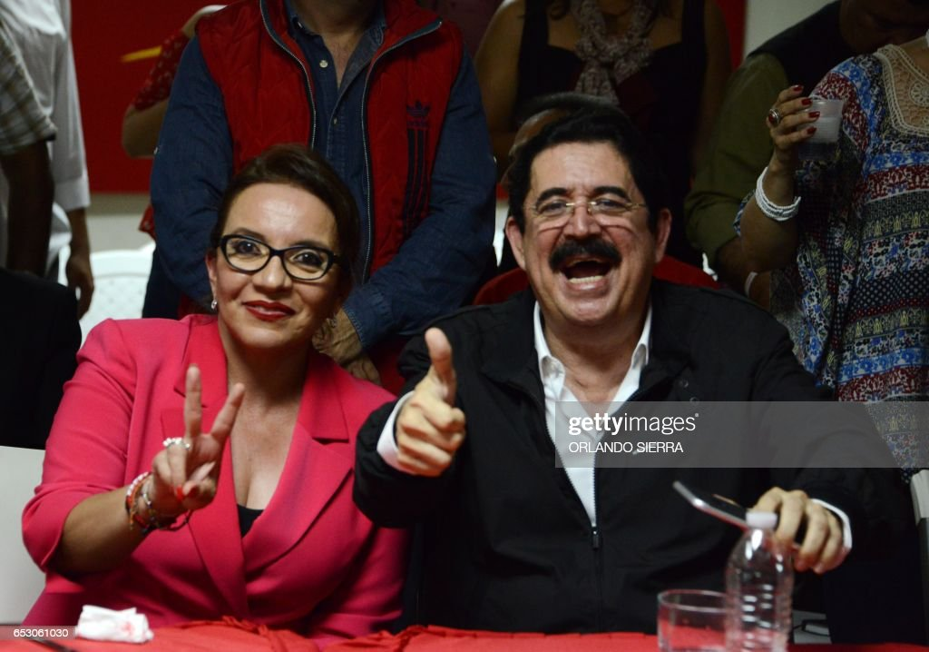 Honduran presidential candidate for the opposition LIBRE party, Xiomara Castro de Zelaya and her husband, ousted president Manuel Zelaya greet the press in Tegucigalpa, on March 13, 2017. SIERRA