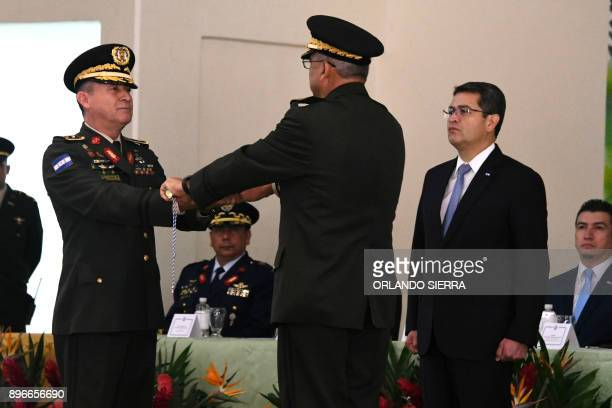 Honduran reelected President Juan Orlando Hernandez attends the command handover ceremony from outgoing General Francisco Isaias Alvarez to the new...