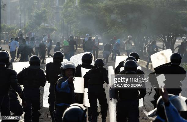 Honduran riot police clash with students of the National Autonomous University of Honduras as they protest in demand of a reduction in the price of...