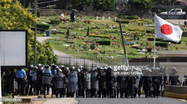 TOPSHOT Honduran riot police members clash with students from the Autonomous National University of Honduras and members of the University Students...