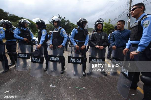 Honduran riot police stand by as migrants heading to the United States with a second caravan wait in Agua Caliente Chiquimula region Guatemala on the...