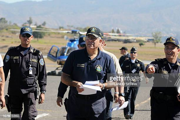 Honduran Security Minister Oscar Alvarez leaves the Tocontin airport in Tegucigalpa on January 7 2011 upon his arrival from Catacamas where Gunmen...