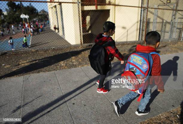 Honduran sixyearold Anthony walks to school on September 10 2018 in Oakland California He and his father Juan fled their country leaving many family...