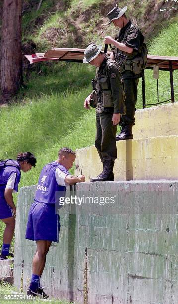 Honduran soccer player Leonardo Morales signs autographs for antiguerrilla soldiers 25 July 2001 during a training session in Manizales Colombia...