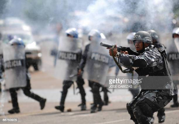 Honduran soldiers and national police shoot tear gas during clashes with protesters nearby the presidential palace in Tegucigalpa on June 29 2009...
