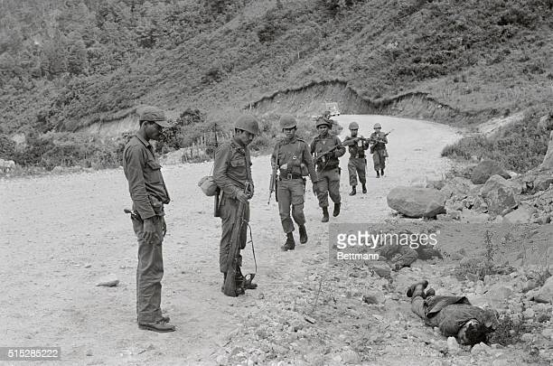 Honduran troops view the bodies of slain Salvadorean soldiers victims of a skirmish on July 18th The body in the foreground is believed to be that of...
