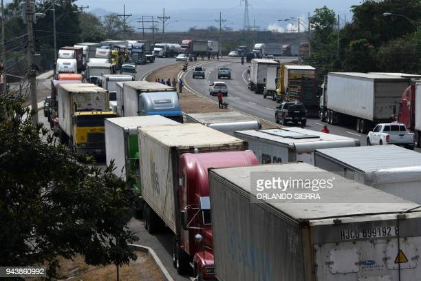 Honduran truck drivers block the CA5 road to protest against the rise in toll rates in Amarateca come 24 kilometres north of Tegucigalpa on April 09...