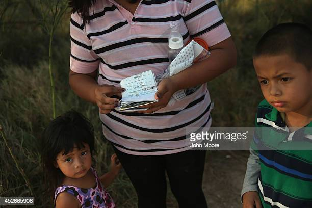 Honduran undocumented immigrant Laura Fabio 2 waits for her mother to check her birth certificate after they crossed the Rio Grande illegally into...