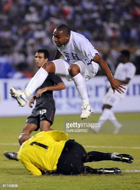 Honduran Wilson Palacios jumps over US goalkeeper Tim Howard during their FIFA World Cup South Africa 2010 Concacaf qualifier football match at...