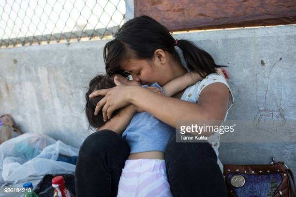 Honduran woman embraces her 2yearold daughter as they wait on the Mexican side of the Brownsville Matamoros International Bridge after being denied...