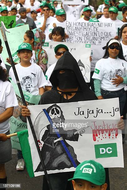 Hondurans march during a demonstration demanding the government to clear up the murder of Security Advisor Alfredo Landa Verde of the Democracia...
