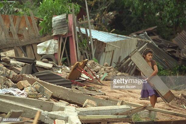Hondurans salvage what they can from the ruined houses