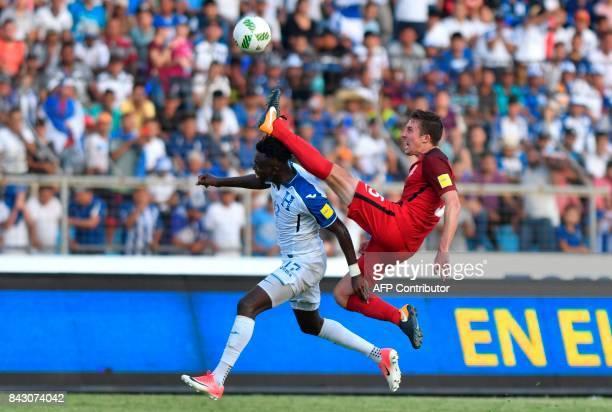 TOPSHOT Honduras' Alberth Elis and USA's Matt Besler vie for the ball during their 2018 World Cup qualifier football match in San Pedro Sula Honduras...