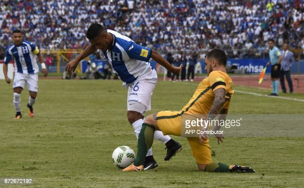 Honduras' Alex Lopez is marked by Australia's Josh Risdon during the first leg football match of their 2018 World Cup qualifying playoff in San Pedro...