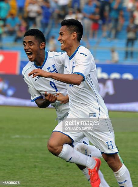 Honduras' Andy Najar celebrates with teammate Antony Lozano after scoring the team's second goal against French Guiana during the Concacaf Gold Cup...