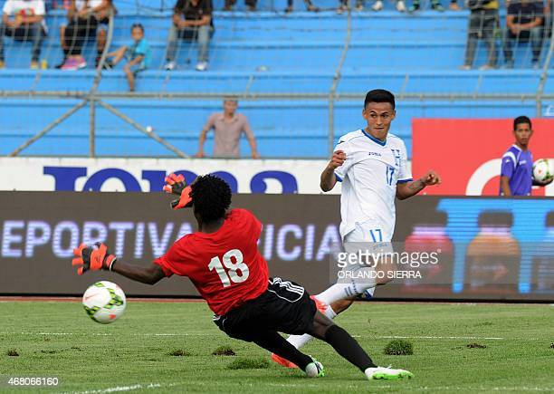 Honduras' Andy Najar shoots over French Guiana's goalie Apagui Janot during the Concacaf Gold Cup qualifying playoff match at the Olimpico...