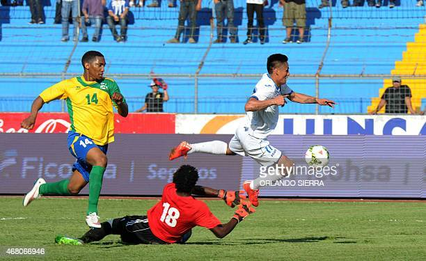 Honduras' Andy Najar vies for the ball with French Guiana's goalie Apagui Janot during the Concacaf Gold Cup qualifying playoff match at the Olimpico...