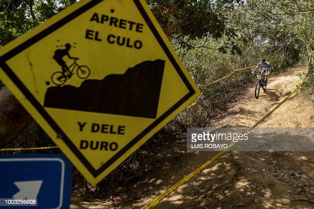 Honduras' Angie Gomez competes in the Women's Mountain Bike Cross Country finals event of the cyclying competition of the 2018 Central American and...