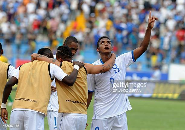 Honduras' Antony Lozano celebrates with teammates the third goal against French Guiana during the Concacaf Gold Cup qualifying playoff match at the...