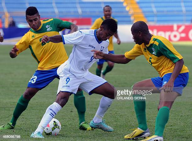 Honduras' Antony Lozano vies for the ball with David Legrand and Serge Lesparence of French Guiana during the Concacaf Gold Cup qualifying playoff...