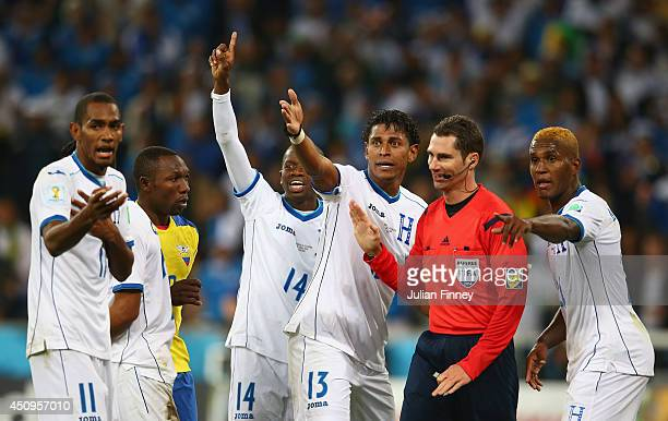 Honduras appeal to referee Benjamin Williams after a call during the 2014 FIFA World Cup Brazil Group E match between Honduras and Ecuador at Arena...