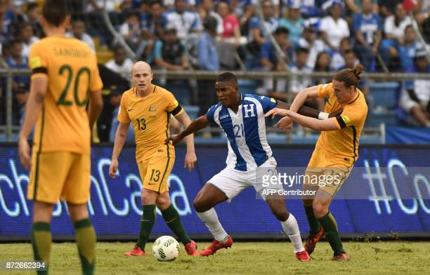 Honduras' Brayan Beckeles is marked by Australia's Jackson Irvine during the first leg football match of their 2018 World Cup qualifying playoff in...