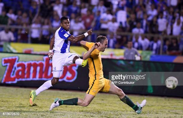 Honduras' Carlo Costly strikes the ball past Australia's Matt Jurman during the first leg football match of their 2018 World Cup qualifying playoff...