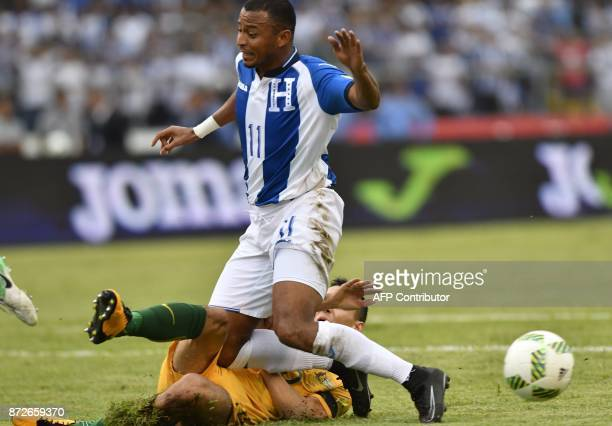 Honduras' Carlos Lanza falls over Australia's Trent Sainsbury during the first leg football match of their 2018 World Cup qualifying playoff in San...