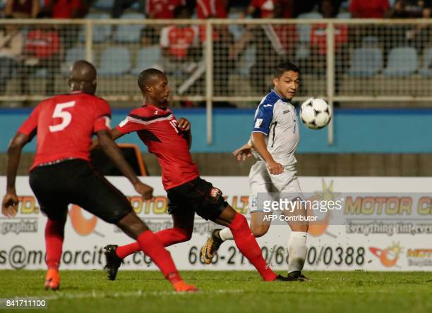 Honduras' defender Henry Figueroa and Trinidad and Tobago's Nathan Lewis vie for the ball during their FIFA World Cup 2018 CONCACAF qualifiers...
