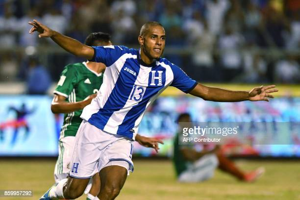 Honduras' Eddie Hernandez celebrates after his team defeats Mexico during their 2018 World Cup qualifier football match in San Pedro Sula Honduras on...