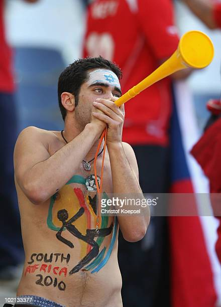 Honduras fan blows a vuvuzela as he enjoy the atmosphere ahead of the 2010 FIFA World Cup South Africa Group H match between Honduras and Chile at...