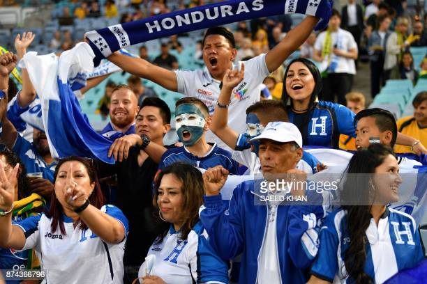 Honduras fan cheer on their team prior to the World Cup 2018 qualifying football match against Australia in Sydney on November 15 2017 / AFP PHOTO /...