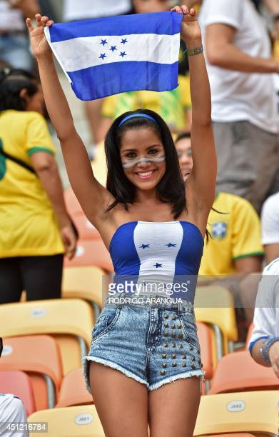 A Honduras fan cheers for her team before the start of the Group E football match between Honduras and Switzerland at the Amazonia Arena in Manaus...