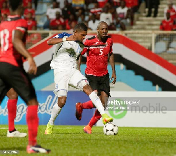 Honduras' forward Carlo Costly and Trinidad and Tobago's Daneil Cyrus vie for the ball during their FIFA World Cup 2018 CONCACAF qualifiers football...