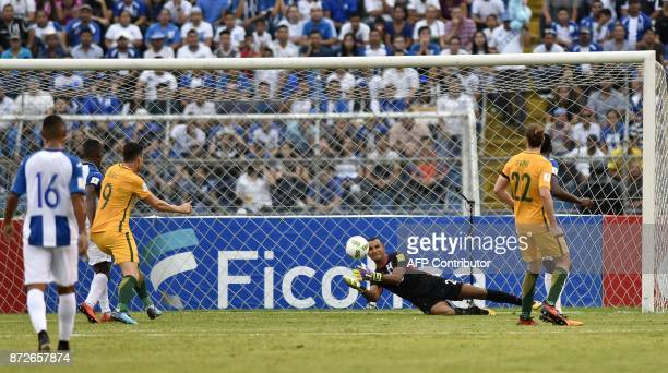Honduras' goalkeeper Donis Escober dives for the ball during the first leg football match of their 2018 World Cup qualifying playoff against...