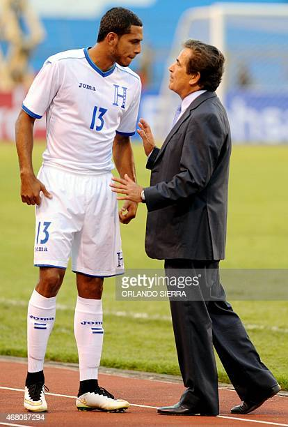 Honduras' head coach Colombian Jorge Luis Pinto gives instructions to forward Eddy Hernandez during the Concacaf Gold Cup qualifying playoff match...
