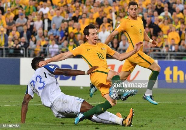 Honduras' Johnny Palacios blocks Australia's Robbie Kruse during their 2018 World Cup qualification playoff football match at Stadium Australia in...