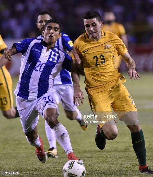 Honduras' Jorge Claros and Australia's Tom Rogic vie for the ball during the first leg football match of their 2018 World Cup qualifying playoff in...