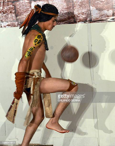 Hondura´s Maya Chorti player Olman Rosales warms up before their Mayan ball game against Guatemala´s Quirigua in Copan Ruinas some 400 kms west of...