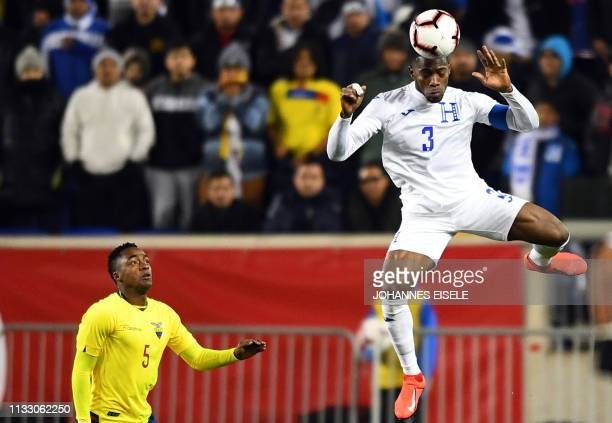 Honduras' Maynor Figueroa heads the ball as Ecuador's Renato Ibarra looks on during the international friendly football match between Honduras and...