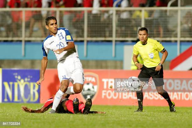 Honduras' midfielder Jorge Claros runs for the ball during their FIFA World Cup 2018 CONCACAF qualifiers football match in Couva, Trinidad and...