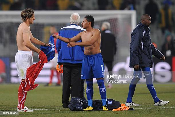 Honduras' midfielder Ramon Nunez exchanges jersey with Switzerland's defender Reto Ziegler at the end of the Group H first round 2010 World Cup...