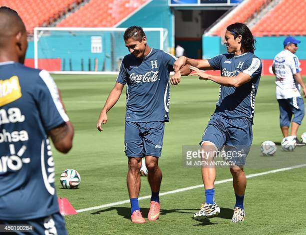 Honduras' midfielder Roger Espinoza jokes with a teammate during a training session at Miami Sun Life Stadium in Miami Gardens Florida on June 6 2014...