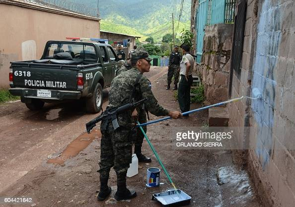 Honduras' Military Police soldiers cover with paint Mara Salvatrucha