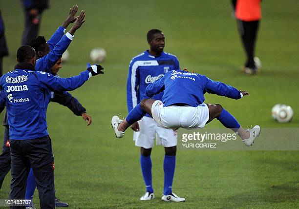 Honduras national footballer Walther Martinez jumps as he jokes with teammates during a training session at the Randburg Stadium in Johannesburg on...