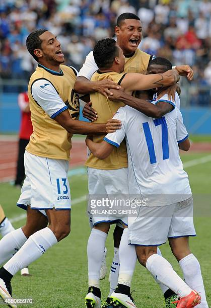 Honduras' players celebrate scoring against French Guiana during the Concacaf Gold Cup qualifying playoff match at the Olimpico Metropolitano stadium...