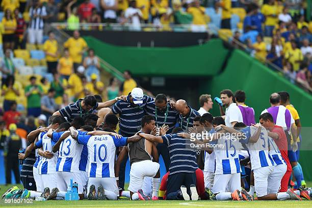 Honduras players huddle after the Men's Semifinal Football match between Brazil and Honduras at Maracana Stadium on Day 12 of the Rio 2016 Olympic...