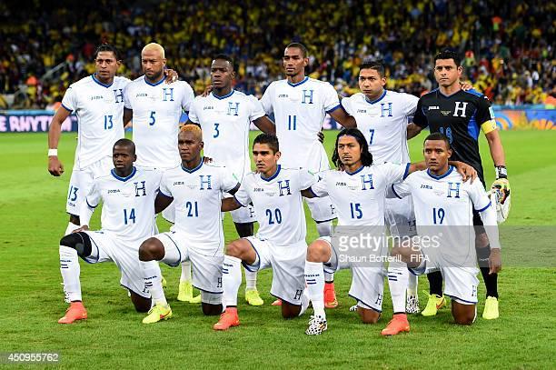 Honduras players line up for the team photos prior to the 2014 FIFA World Cup Brazil Group E match between Honduras and Ecuador at Arena da Baixada...