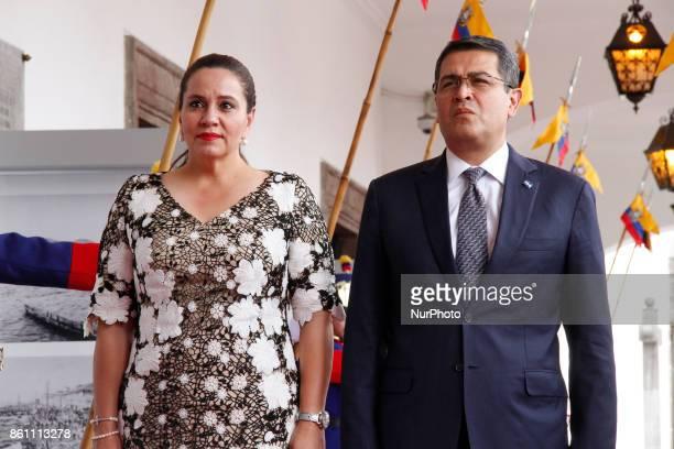 Honduras' President Juan Orlando Hernandez and first lady Ana Garcia, enter the Palace of Carondelet during a state visit, in Quito, Ecuador, October...