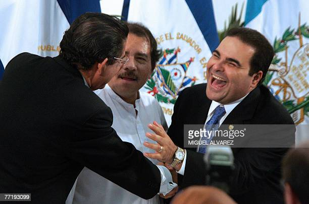 Honduras' president Manuel Zelaya shakes hands and makes a joke with Salvador's president Antonio Saca as Nicaragua's president Daniel Ortega looks...